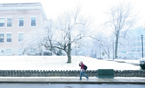 A student walks down Washington Avenue Wednesday morning after some early-morning snowfall, which has rare so far this winter.