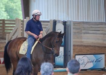 Chris McCarron on a Thoroughbred horse