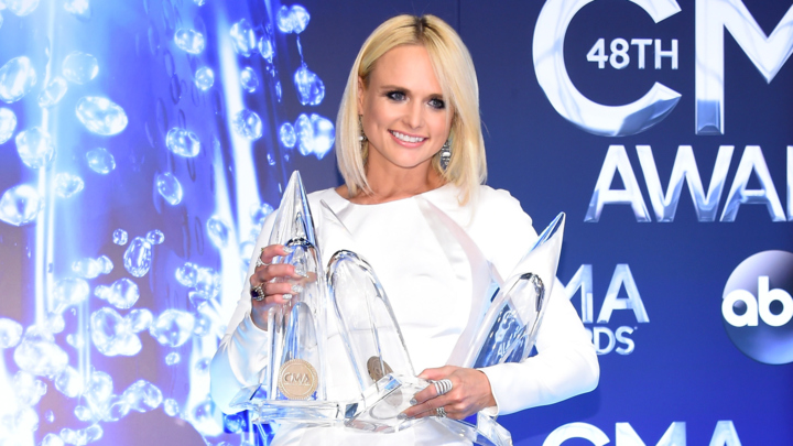 Miranda Lambert poses in the press room with her awards at the 48th annual CMA Awards. (Photo by Larry Busacca/Getty Images)